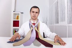Chousing the best necktie for a working day Royalty Free Stock Images
