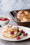 Choux cake Paris Brest with raspberries Stock Photos