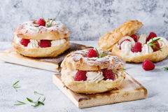 Choux cake Paris Brest with raspberries Royalty Free Stock Photography