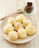 Choux Cream, Cream puff. On wooden table Stock Image