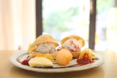 Choux cream ice cream with fruits. On a plate stock photos