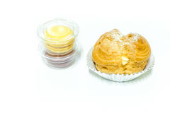 Choux cream and macarons Stock Photos