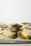 Choux Cream Puff Pastries with Copy Space Stock Photography
