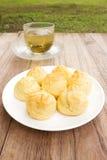 Choux cream on white plate. Stock Photos