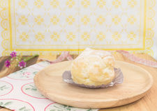 Choux cream on wood plate Stock Photography