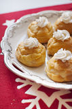 Choux a la creme. Festive choux a la creme on vintage platter Royalty Free Stock Photo