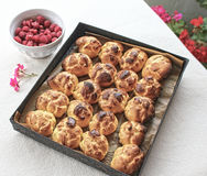 Choux a la creme. Homemade choux pastry ball placed on baking tray and bowl of fresh raspberries Royalty Free Stock Image