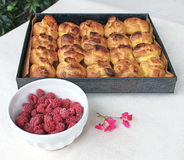 Choux a la creme 9. Homemade choux pastry ball placed on baking tray and bowl of fresh raspberries Stock Images