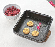 Choux a la creme 10. Homemade raw dough choux pastry ball placed on baking tray and bowl of fresh raspberries Royalty Free Stock Photo