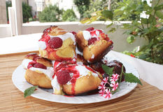 Choux a la creme with raspberry 1. Homemade choux pastry ball filled with cream, vanilla pastry cream and raspberry Stock Images