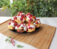 Choux a la creme with raspberry 6. Homemade choux pastry ball filled with cream, vanilla pastry cream and raspberry Royalty Free Stock Photography