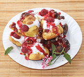Choux a la creme with raspberry 8. Homemade choux pastry ball filled with cream, vanilla pastry cream and raspberry Royalty Free Stock Photos