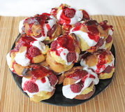 Choux a la creme with raspberry 10. Homemade choux pastry ball filled with cream, vanilla pastry cream and raspberry Royalty Free Stock Images