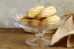 Choux pastry eclairs on glass stand base Stock Photo