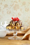 Choux pastry eclairs on glass stand base Royalty Free Stock Photo