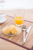 Choux pastry and orange juice Royalty Free Stock Photography