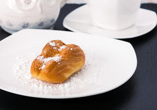 The choux pastry on a white plate Royalty Free Stock Image