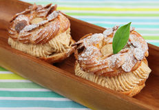 Choux Pastry in wooden plate Stock Photo