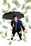 Chovendo o dinheiro Fotografia de Stock