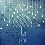 Chover e guarda-chuva em um vintage borram o fundo Fotos de Stock