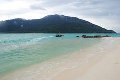 Chover na praia Imagem de Stock Royalty Free