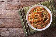 Chow Mein: fried noodles with chicken, horizontal top view. Chow Mein: fried noodles with chicken and vegetables. horizontal view from above royalty free stock images