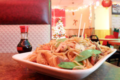 Chow Mein. Noodles with assorted meats and vegetables at a Chinese Restaurant on Christmas Royalty Free Stock Photo