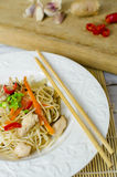 Chow mein noodles with chicken, mushrooms, carrots and onions stock images