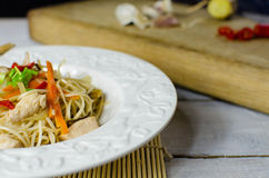 Chow mein noodles with chicken, mushrooms, carrots and onions Stock Photography
