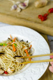 Chow mein noodles with chicken, mushrooms, carrots and onions Royalty Free Stock Image