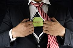 Chować depresję Mężczyzna w kostiumu i czerwonym krawacie otwiera jego wewnętrzną koszula wyjawiać jego depresję i rozpina Słowo  fotografia royalty free