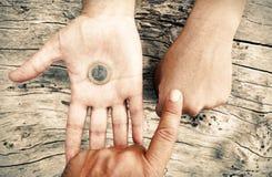 Chowana moneta Obraz Royalty Free