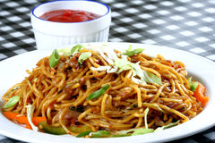 Chowmein in plate with sauce Royalty Free Stock Photo