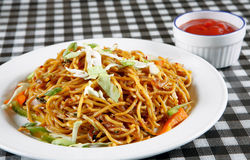 Chowmein in plate with sauce Royalty Free Stock Images