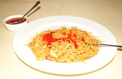 Chowmein, served hot in breakfast with red tomato ketchup. Royalty Free Stock Image