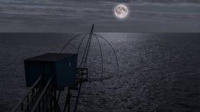 Choza de la pesca en la noche