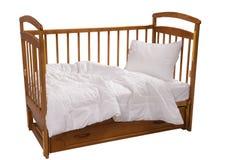 Choza de madera con la manta y la almohada aisladas en el fondo blanco Imagen de archivo