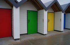 Chozas coloreadas de la playa Foto de archivo libre de regalías