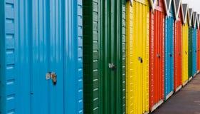 Chozas coloridas de la playa Imágenes de archivo libres de regalías