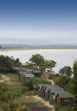 Chozas de la playa en Studland imagenes de archivo
