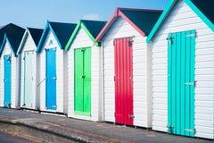 Chozas de madera coloridas en la playa Fotos de archivo