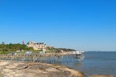 Chozas del pescador en la costa Imagenes de archivo