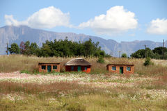 Chozas tradicionales de Sothu en el Drakensberg Imágenes de archivo libres de regalías