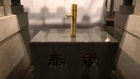 Chozuya or Chozuba or washbasin at Hakusan shinto shrine, Tokyo. Tokyo,Japan-January 6, 2018: Chozuya or Chozuba or washbasin is a place for the people to wash stock video footage