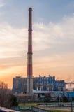 CHP with high chimneys at dusk Royalty Free Stock Photo