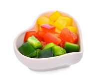 Chpopped sweet bell pepper or capsicum in the white. Heart cup isolated on white background stock photos