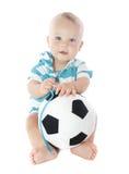 Chéri avec la bille de football Photographie stock