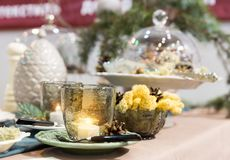Chrictmas table with pinecones and candles Stock Photography