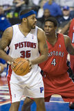 Chris Bosh Guards Rasheed Wallace. Chris Bosh of the Toronto Raptors guards Rasheed  Wallace during a game against the Detroit Pistons on February 11, 2007, in Royalty Free Stock Image