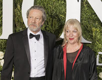 Chris Cooper and Marianne Leone Cooper. Actor Chris Cooper and wife Marianne Leone Cooper arrive on the red carpet for the 71st Annual Tony Awards at the Royalty Free Stock Photo